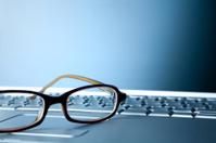 Eye Glasses Sitting on Top of Laptop