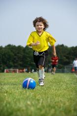 soccer player chasing ball