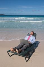 Businessman Lies Back w Laptop