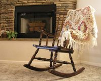 Rocking chair by fireplace