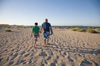Man And Boy At Beach