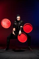 juggler in costume with make-up on black background