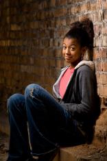 Teen against wall