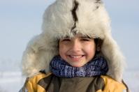 Little boy winter  portrait in the fur-cap