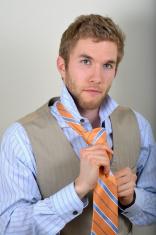 Handsome man tying a tie