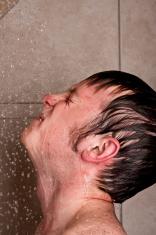 Teenage boy taking a shower
