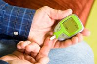 Man Performs Glucose Blood Test