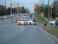 Police cars block traffic