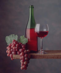 Red wine bottle, glass, grapes, clear focus