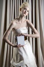 Bride holds blank stationary