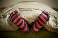 funny toes sock under the duvet