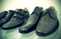 Men's shoes on glass shelf