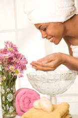 young woman washing face