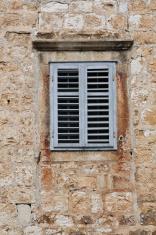 Shuttered Window in Stone Wall