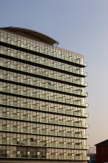 Postmodern Glass Apartment Block with clear evening sky