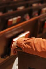 Sitting in church pew using armrest