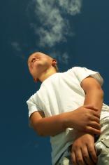 Little boy over blue sky