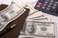 Money, calculator and pen