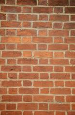 Simple Orange-Hue Brick Wall Vertical