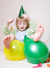 Little girl playing with balloons.