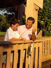 Boy and Grandfather fishing