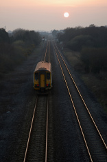 Setting sun on railway tracks
