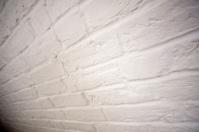 wide angle shot of white brick wall
