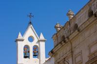 medieval church tower against blue sky