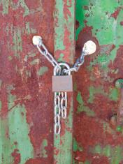 Padlock with chain in a door. Series