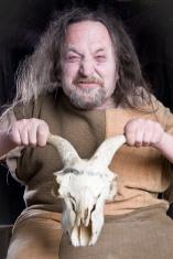 Crazy old man holding Goats skull