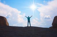 Man Raising Arms in Praise