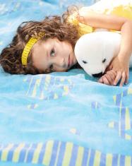 baby girl on a beach towel