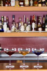 Three glasses on a bar