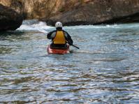 Kayaker entering the river