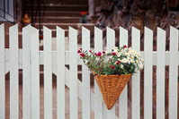 White Fence with basket of flowers