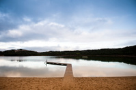 Boardwalk pier over water lake Beach Port South Australia