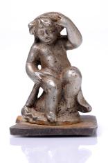 Little old cherub statue