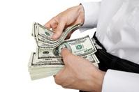 counts money in hands