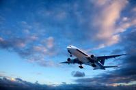 Jet Aeroplane Taking Off Into Bright Twilight Sky