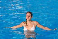 woman relaxing in a swimmingpool