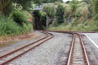 Railway tracks leading to tunnel