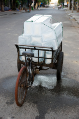 blocks of ice melting on street in Nha Trang, Vietnam