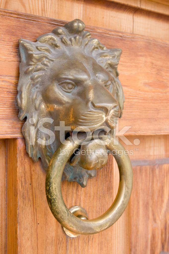 Lion head door knocker stock photos - Lion face door knocker ...
