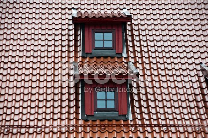 Mansard With Windows And Tilled Roof Stock Photos