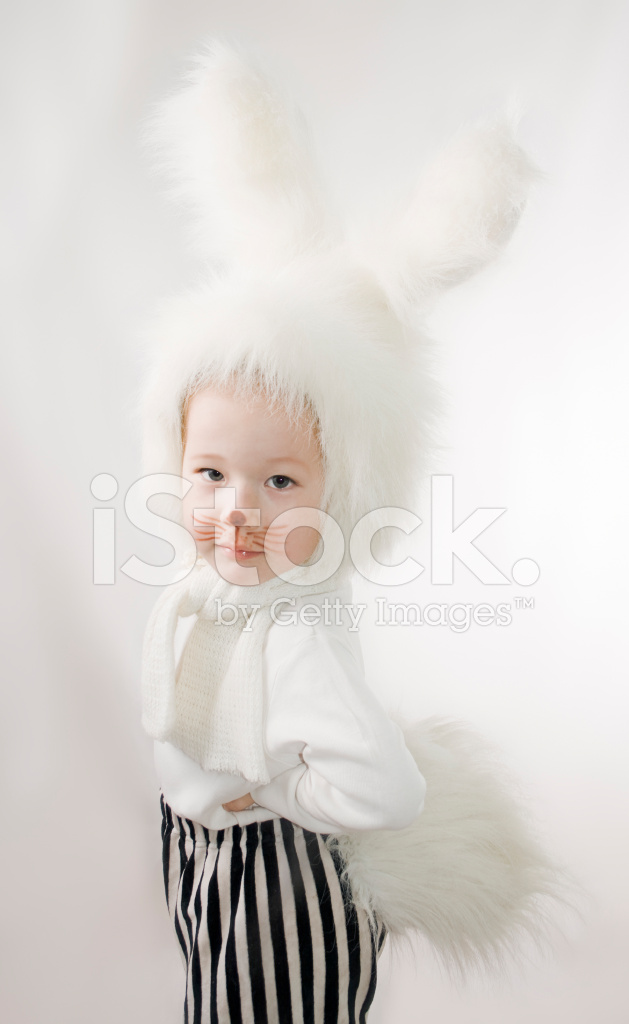 Little Girl In A White Downy Bunny Stock Photos Freeimagescom