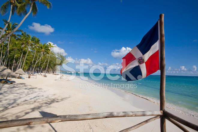 Dominican Republic Flag In The Beach Stock Photos