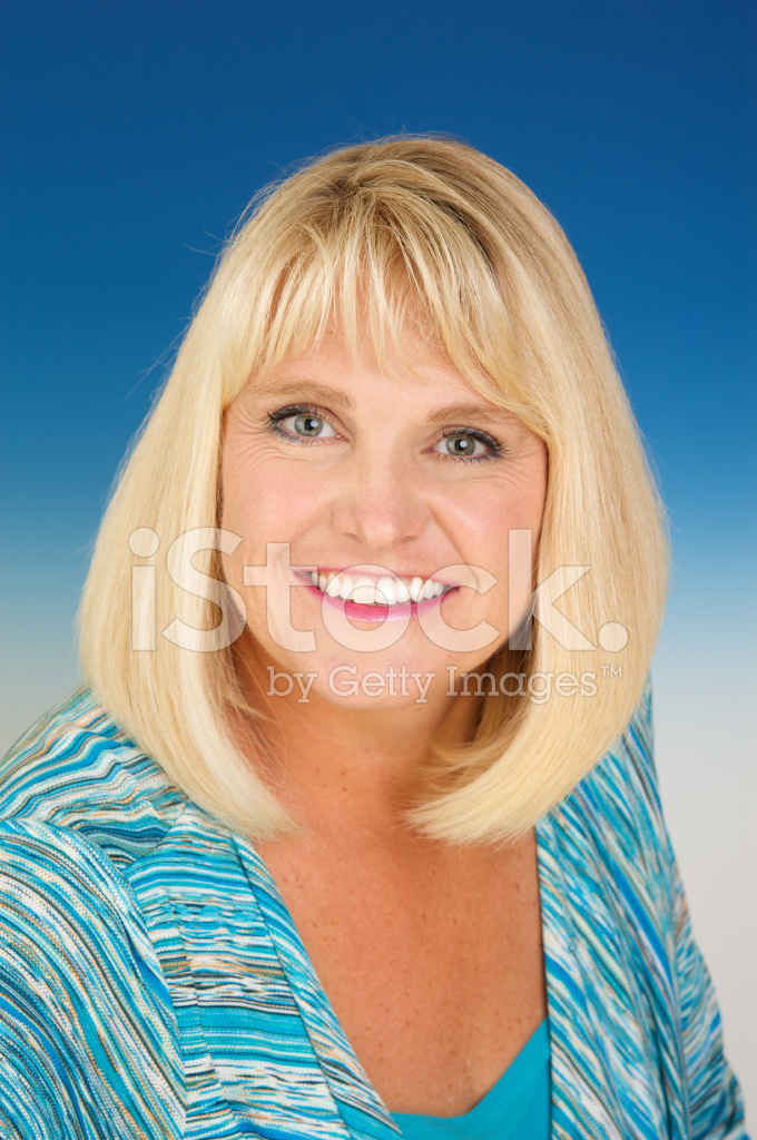 Beautiful Smiling Blond Forty Year Old Woman On Blue Stock
