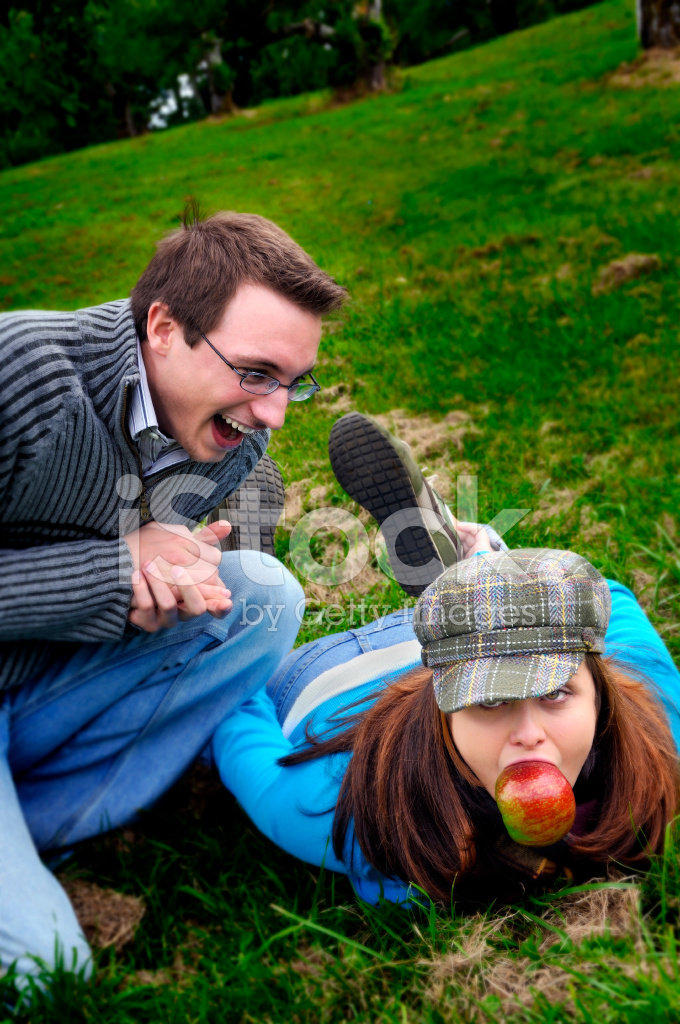 Man Excited Over Girl With Apple In Mouth Stock Photos