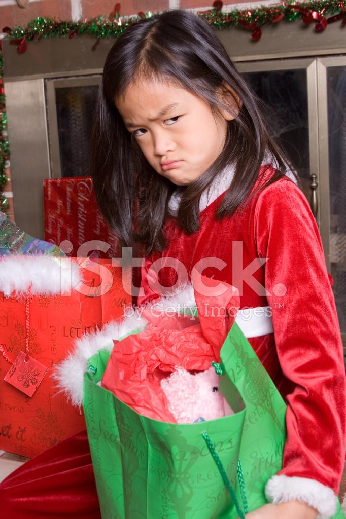 Undankbar Mädchen MIT Weihnachtsgeschenke Stockfotos - FreeImages.com