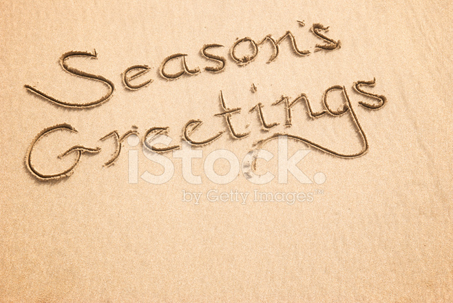 Seasons greetings calligraphy message in sand stock photos seasons greetings calligraphy message in sand m4hsunfo